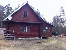 Дом  на хуторе вблизи леса и озера